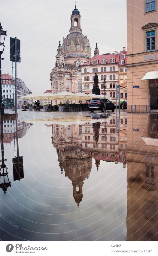 sandstone mountains Frauenkirche Dresden Baroque famous Historic Landmark Tourist Attraction houses Window Puddle Reflection Water Old town
