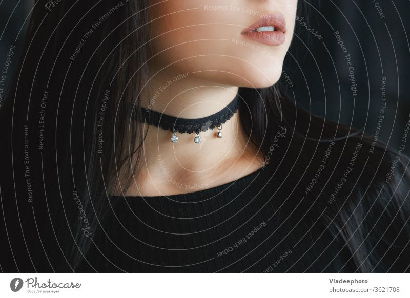 Close up of stylish black choker on female neck beauty model style necklace woman fashion young beautiful modern person skin background girl glamour jewelry