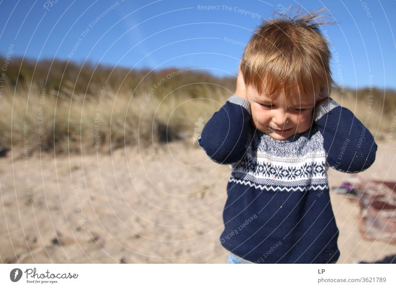 Little boy hlding his hands on the ears refusal Against Exterior shot hearing Hearing impairment Hearing protection Hearing aid Denial Sense of hearing