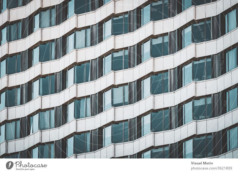 Irregular facade of an urban building creating a pattern windows architecture architectural architectonic metropolitan constructed edifice structure geometric