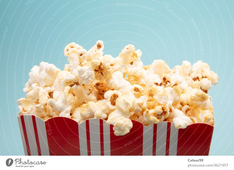 Salted Popcorn popcorn snack isolated paper white background cup movie red cinema nobody food entertainment salty delicious bucket carton box classic big large