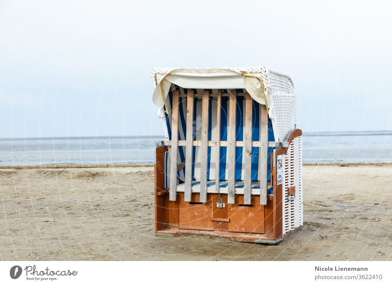 Beach chair at the North Sea beach in Germany beach chair Chair White Ocean Sky Water Blue travel Landscape Nature Coast Summer bank Wave cloud Sand Picturesque