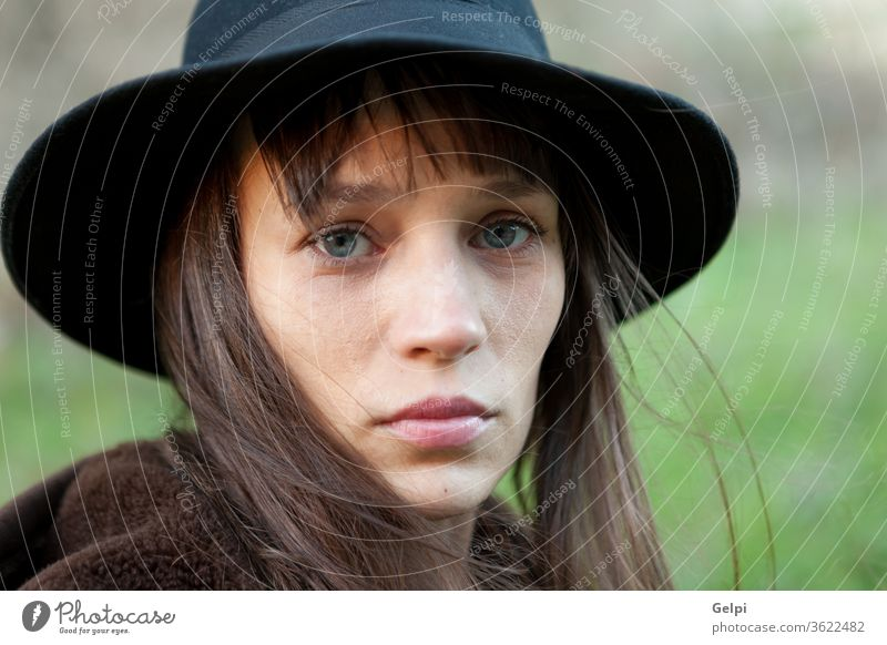Sad woman with black hat beautiful sad person portrait young lifestyle girl female pretty beauty attractive people fall caucasian autumn model lady face outdoor