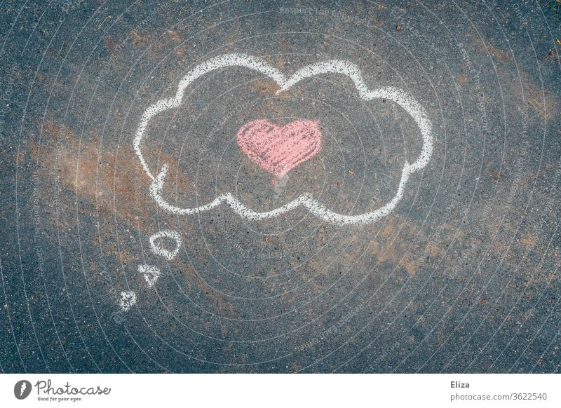Love in the head. Chalk painted thought cloud with a pink heart in it on asphalt. Valentine's Day. In love Thought Cloud romantic Heart Romance Emotions