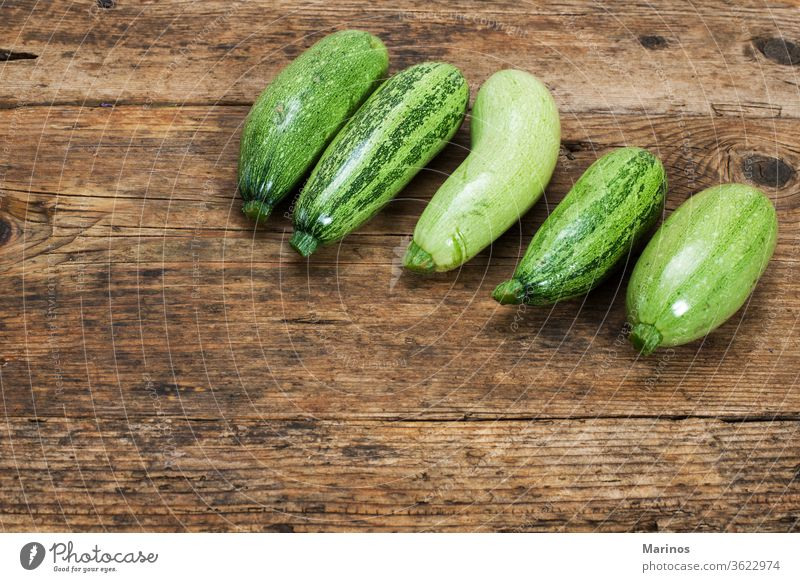 zucchinies on a wooden table background vegetable squash marrow design fresh green food healthy natural plant package group organic nutrition ingredient
