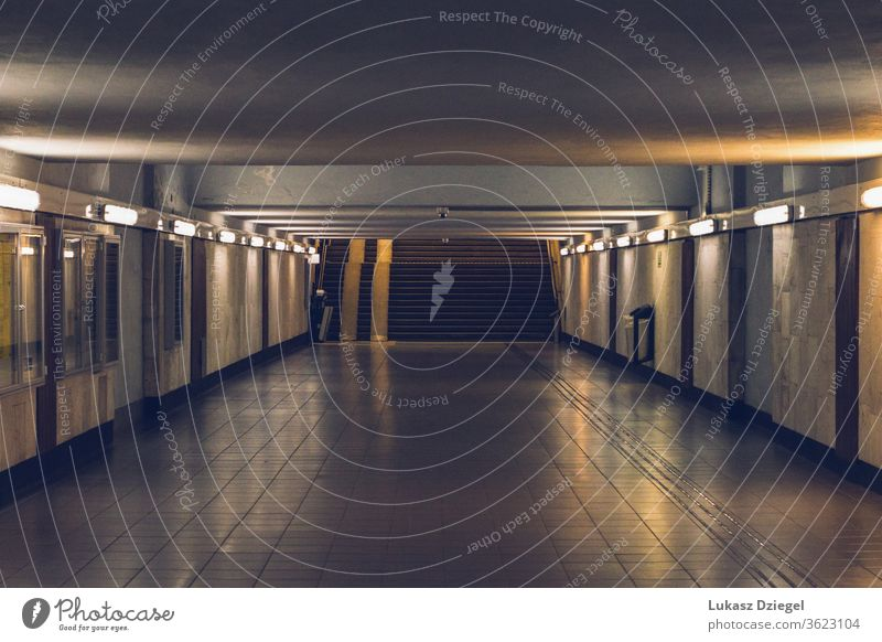 Underground passage with no people on the evening tourism european passageway city tunnel access stairs long peaceful platform empty interior modern public