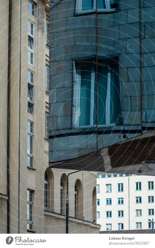 Abstract View of a three downtown buildings close-up no people metropolis outdoor reflection mirror glasses technology windows travel city urban blue structure