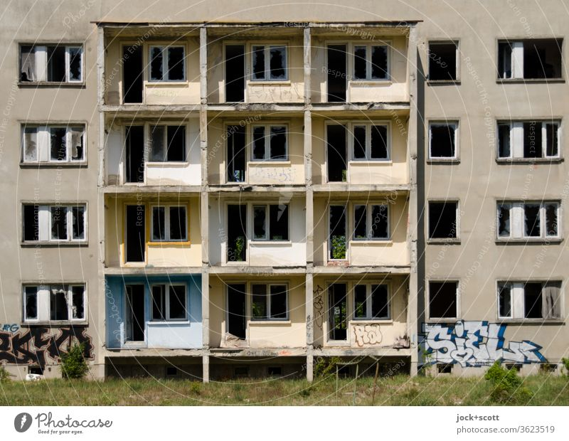 Panel building, away from the window GDR Uninhabited Vacancy House (Residential Structure) Vista Gloomy Agreed Symmetry Ruin Apocalyptic sentiment Sunlight Old