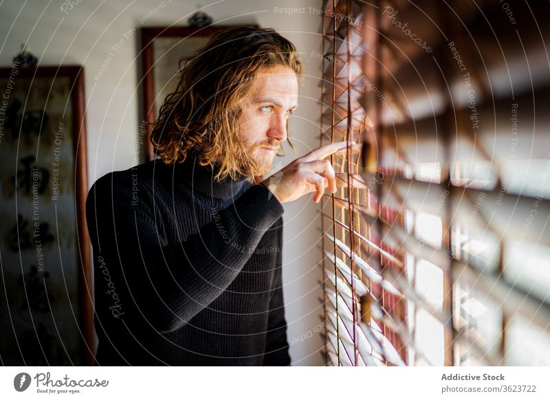 Mature man looking out window home enjoy weekend mature calm peaceful street observe male casual rest chill relax harmony cozy tranquil serene serious