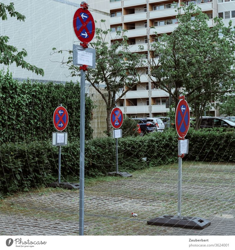 No stopping signs on a parking lot in front of the facades of high-rise buildings in Berlin-Tegel No standing Clearway Signs Road sign Parking lot Facade