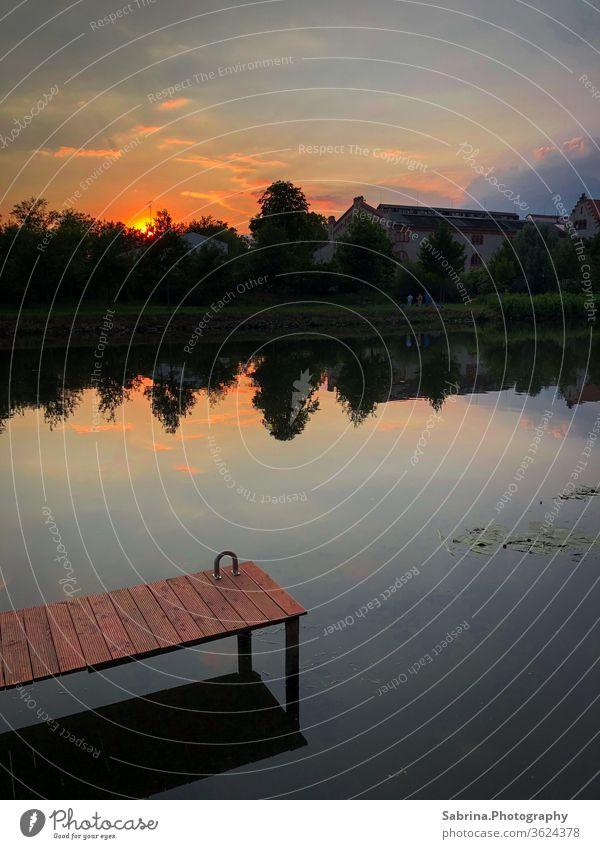 Summer sunset on the banks of the river Saale in Halle, Saxony-Anhalt Halle (Saale) Germany River River bank Footbridge Sunset Sunbeam Sky Colour photo Deserted