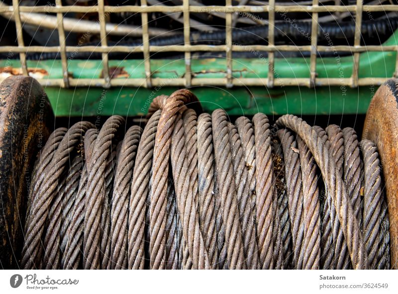 Old sling cable of electric winch in front of 4wd car steel old metal equipment vehicle rust rope gear hoist tow close up help pull off road