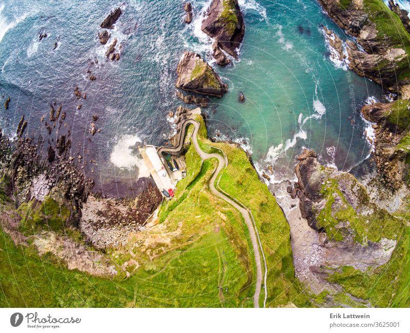 Amazing aerial view over Dunquin Pier Ireland on Dingle Peninsula Slea Head Vacation coast landscape nature ocean sea travel Kerry scenic summer water blue rock