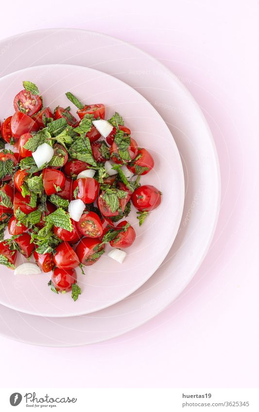 Homemade cherry tomato salad with fresh onions, mint, olive oil and salt vegetable healthy food tomatoes diet leaf red organic green ingredient meal appetizer
