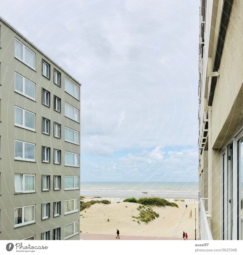 View through a canyon of houses on a sandy beach gorge of houses Beach Belgium added Built-in sand dune To go for a walk Ocean Coast North Sea Water