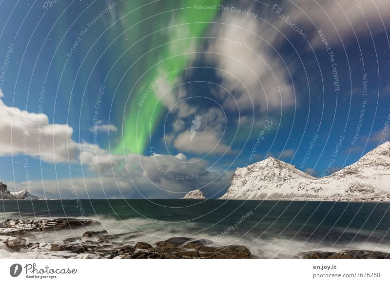 Northern lights in Haukland northern lights Clouds Lofotes Norway Haukland Beach mountains Snow Winter Ocean Coast Rock Night sky Long exposure Scandinavia