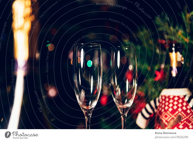 Xmas or New Year Party with champagne bottle prosecco xmas christmas flute glasses holiday wine celebration alcohol two drink table winter toast happy tree