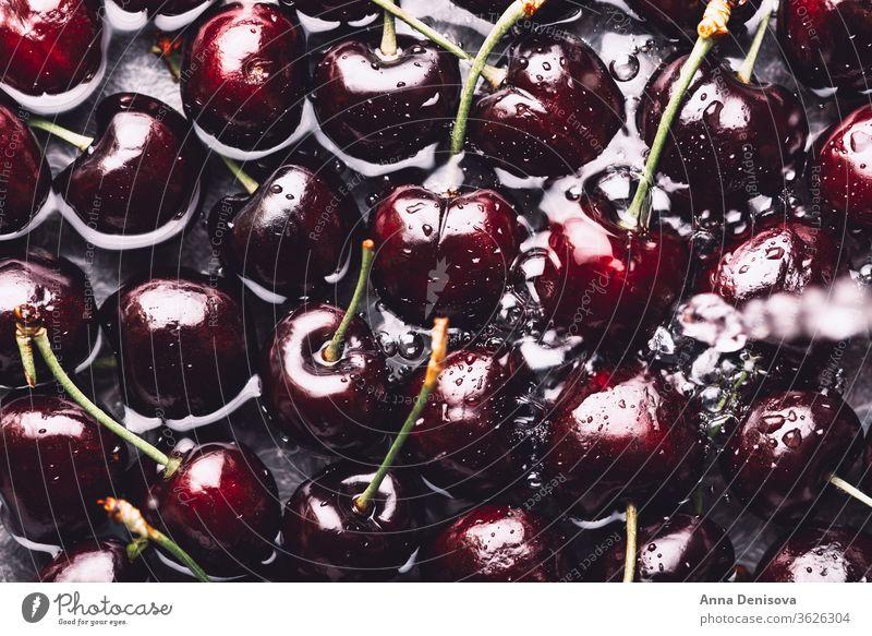 Macro of Fresh cherries raspberry cherry summer raspberries ripe delicious wash wet water nutrition tasty diet red food sweet nutritious garden macro top view