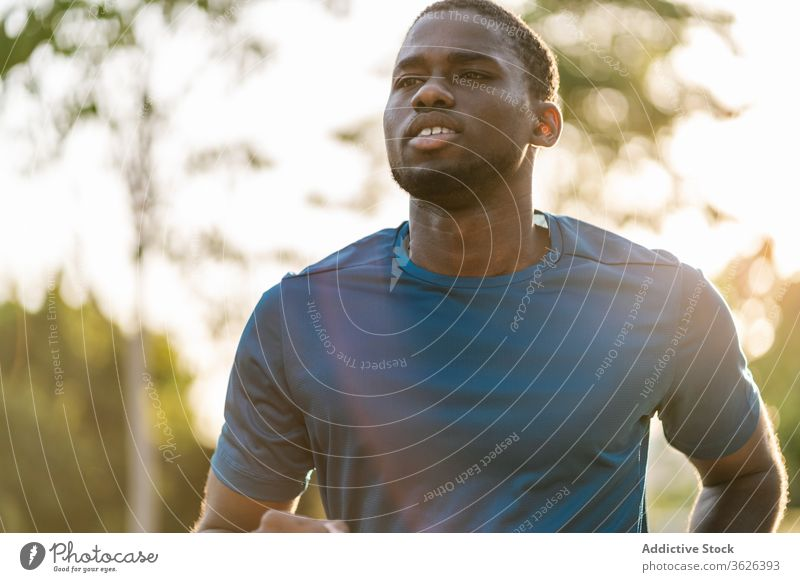 Black man running outdoors african jog black training fitness sport healthy park runner active people jogger lifestyle summer male exercise workout adult