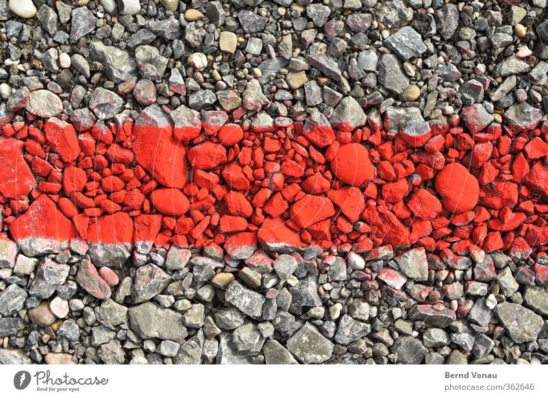 Stones in the red area Parking lot Signs and labeling Illuminate Lie Gray Red Gravel Boundary Border Line Colour Flashy Contrast Problem solving Temporary dyed