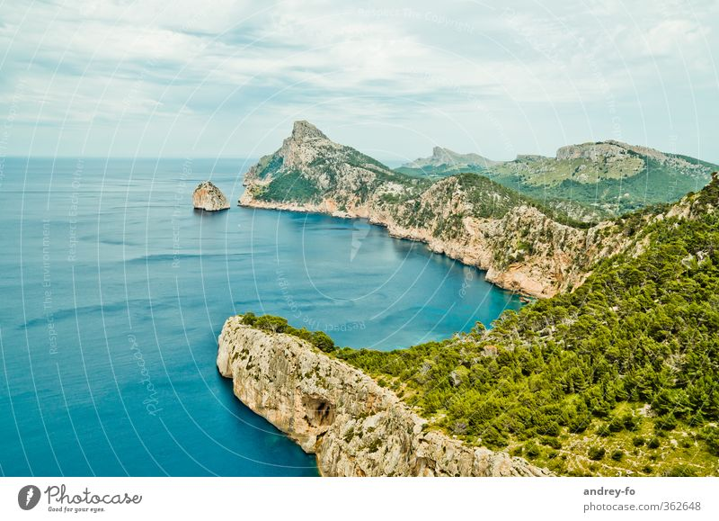 Cap Formentor Tourism Far-off places Freedom Summer Ocean Island Mountain Rock Nature Landscape Elements Sky Clouds Storm clouds Peak Coast Lakeside Bay