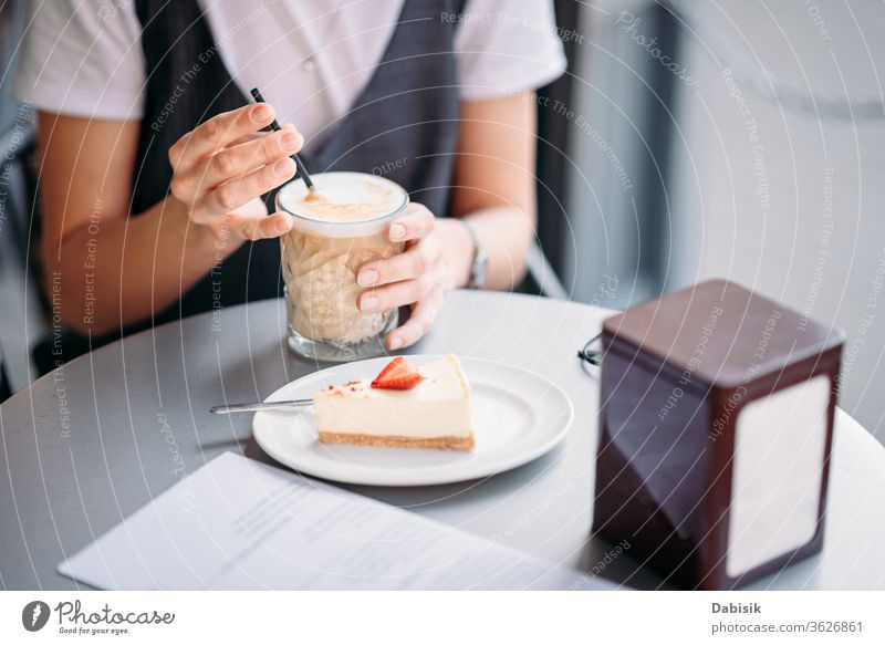 Woman drinks coffee at cafe outdoor in summer day woman breakfast cake cup hand lifestyle table food morning espresso female business girl restaurant mug hot
