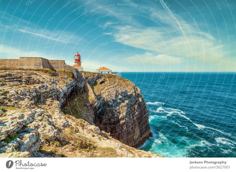 Lighthouse at the end of Saint Vincent Cape, Portugal lighthouse portugal ocean algarve rocks waves architecture atlantic beacon beautiful blue building cape