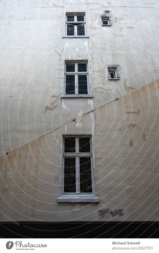 Old, grey house wall with five windows Gray Wall (building) Facade House (Residential Structure) Colour photo Architecture Gloomy Subdued colour