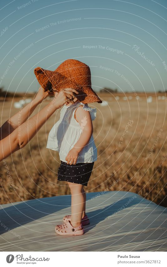 Child with straw hat childhood Childhood memory Infancy Playing Girl Colour photo Hand Parenting Summer Nature 1 - 3 years Leisure and hobbies