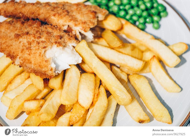 Fish and Chips with peas fish chips food haddock hake battered cod english crispy fillet dinner british fried meal seafood french potato plate dish cooked