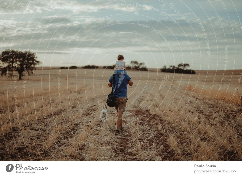 Father with daughter Carrying Shoulder shoulders Walking Family & Relations Father with child Field Summer Summer vacation Travel photography travel Pet Dog Man