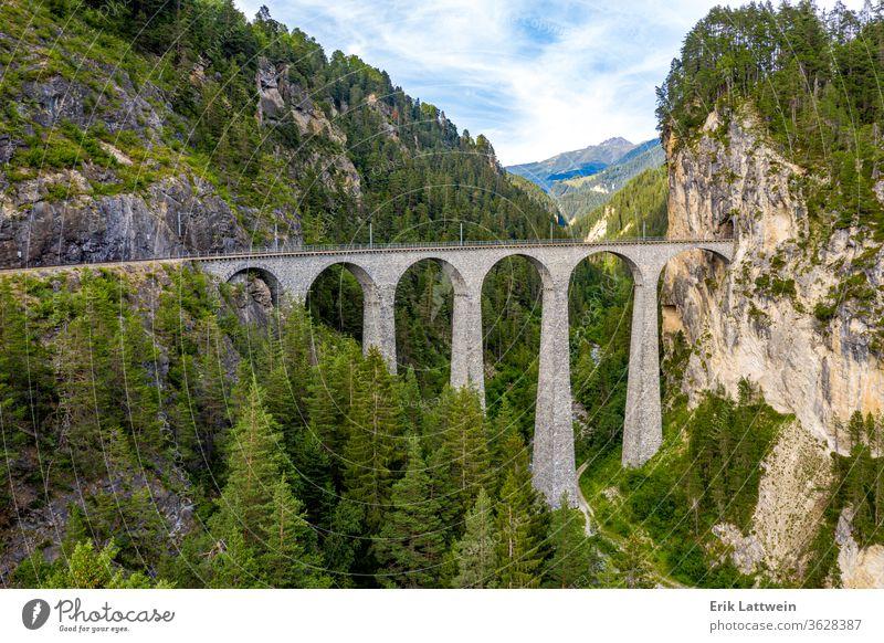Famous viaduct near Filisur in the Swiss Alps called Landwasser Nature aerial photography Switzerland travel view alps cloud landscape high horizon idyllic