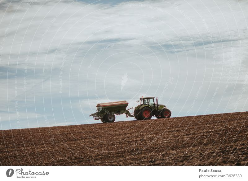 Tractor in fields against the sky Machinery Agriculture Agricultural crop Environment Work and employment Harvest Agricultural machine Day Deserted Forestry