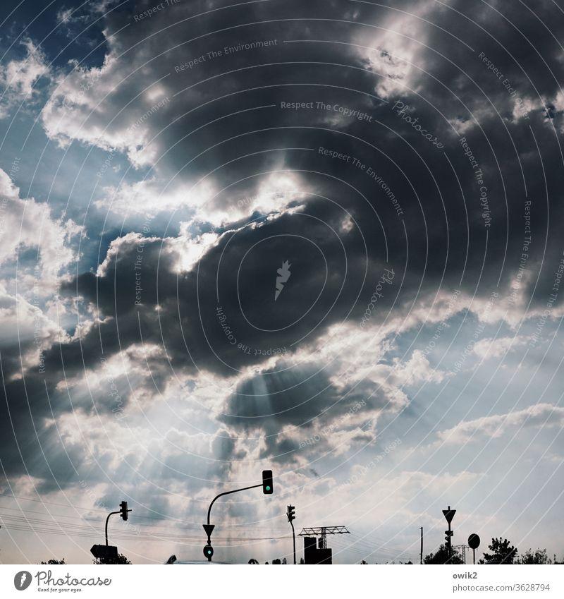 Traffic lighting Sky Clouds Sunlight Dramatic Light Breakthrough Light (Natural Phenomenon) Storm clouds Contrast Road traffic Exterior shot Deserted