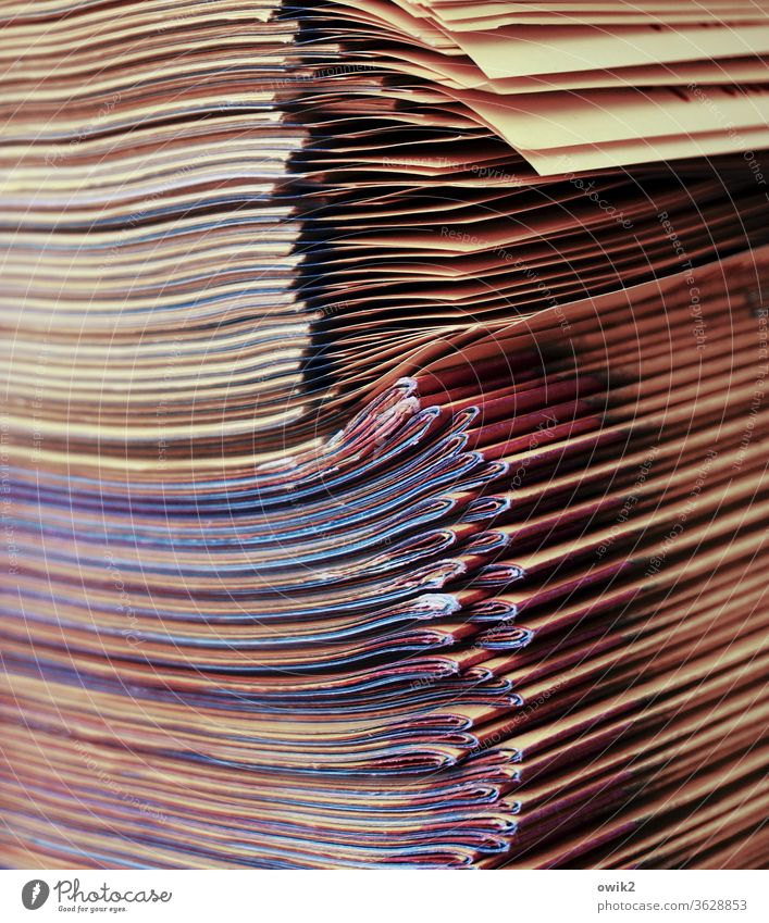 Media hype newspapers Stack Many quantity mass Supply stacked variegated stapled Folded Arrangement Exterior shot Paper Print media Piece of paper