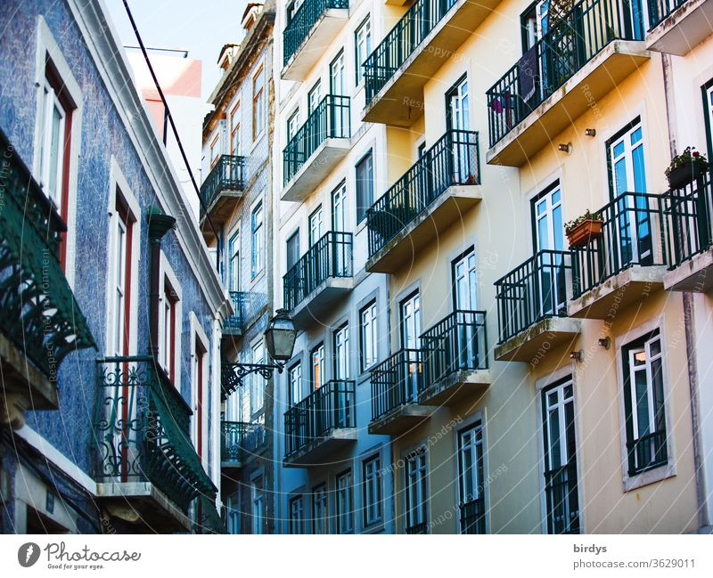 House facades with balconies. Renovated old buildings in the city Facades Window Balconies Old building dwell Multistory Town Authentic Apartment house