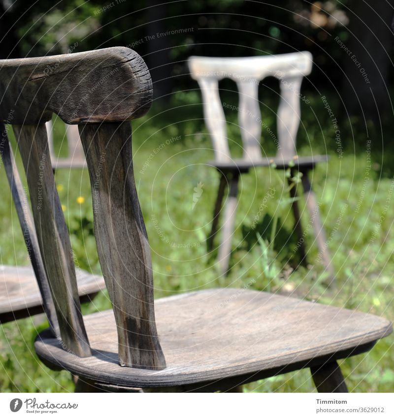 Chair circle, partial view Wooden chair Backrest chair legs Seat Seating wood Old Brown Furniture Grass Meadow green Deserted Loneliness
