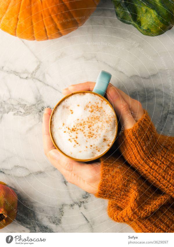 Autumn flat lay with mug of latte coffee autumn hands sweater orange christmas woman food winter marble above light milk moody morning october november pumpkin
