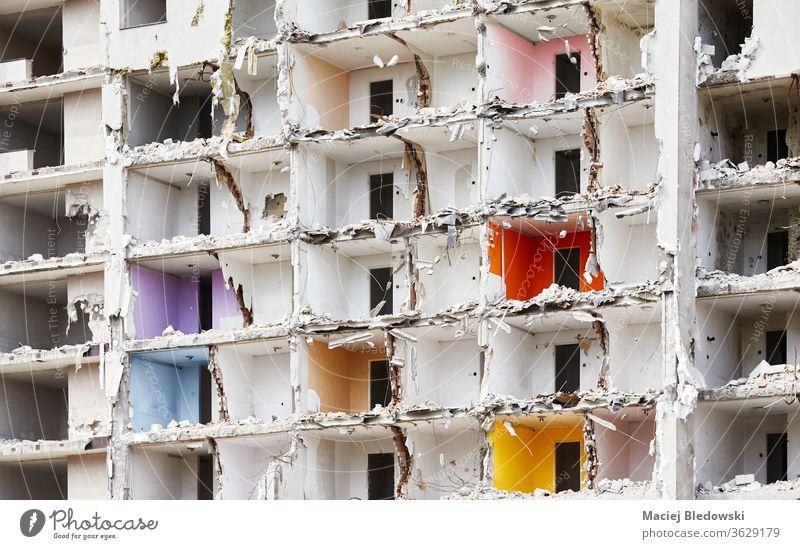 Demolished high rise building without front wall. destruction rubble house bomb earthquake war ruin explosion city demolished debris danger concrete old
