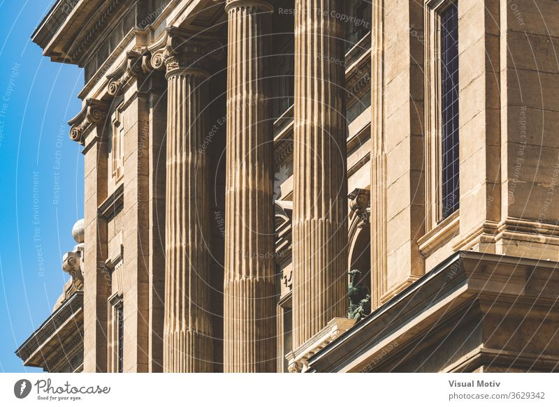 Facade with Ionic columns of the National Art Museum of Catalonia in Barcelona aka MNAC building ornament historic old statue sunny monument exterior