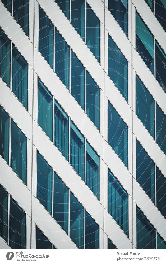 Symmetrical blue windows of an office building made of aluminum and glass abstract abstract background abstract photography afternoon architectonic