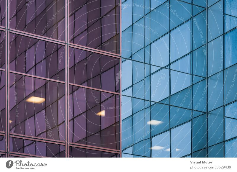 Reflections on the corner of the glass facade of an office building reflection evening exterior modern reflective mirror construction contemporary urban city