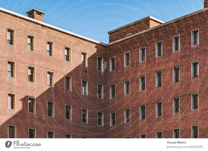 Symmetrical facades of an old brick building symmetrical structure abstract color urban exterior window repetition pattern row outdoors design architectural