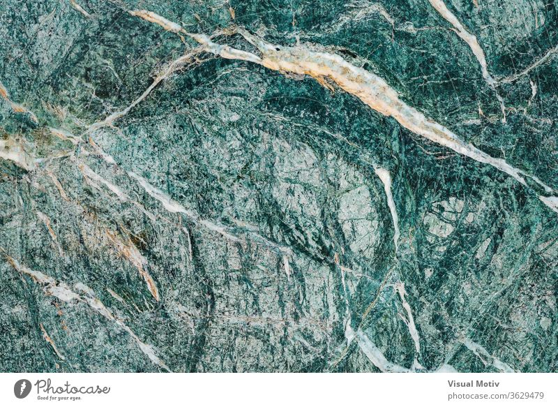 Texture of an Alpine greenish marble slab with white veins texture alpine surface stone calcareous background rough aesthetic material mineral abstract natural