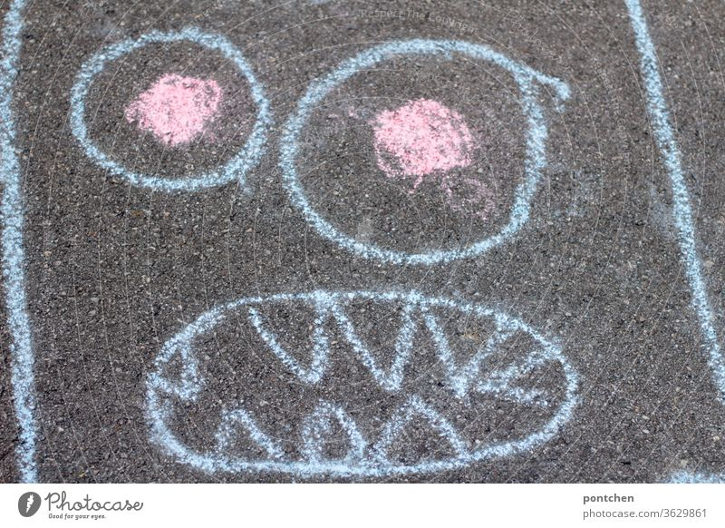 Piece of cake. Face of a monster painted with street chalk Monster Painting (action, artwork) Draw Children's game Creativity Infancy Chalk Leisure and hobbies