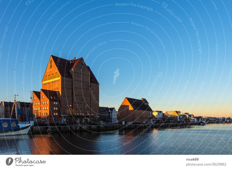 The city harbour in Rostock in the morning Town River ship Mecklenburg-Western Pomerania Warnov Harbour Architecture houses built boat Landmark