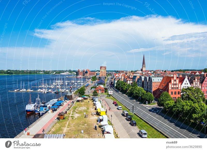 View of the city harbour of the Hanseatic City of Rostock Town River Warnov Mecklenburg-Western Pomerania Architecture houses built Landmark Tourist Attraction