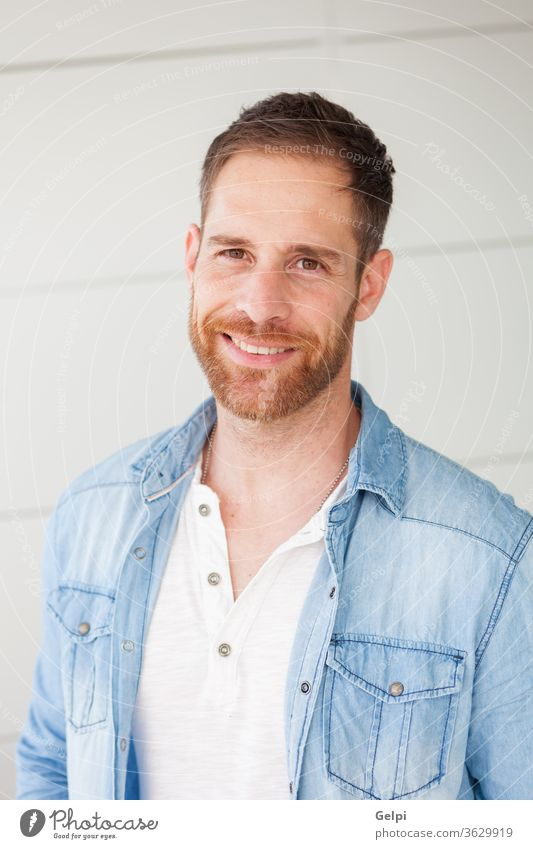 Portrait of a casual guy with denim shirt male young handsome man model beard fashion portrait attractive people adult person confident style jeans modern face