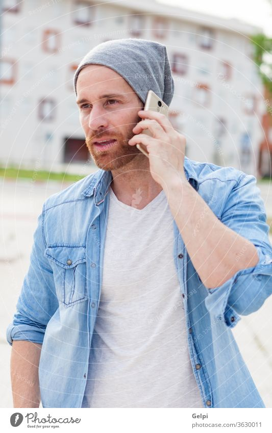 Casual fashion guy calling with his mobile casual phone young male lifestyle man speak person beard adult attractive hipster technology handsome people