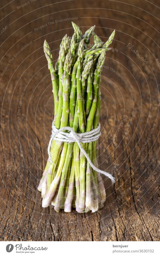 wild green asparagus on wood Asparagus Rustic Bundle Thread threads Nutrition Food ingredient Diet White Vegetable Fresh Heap salubriously background Delicious